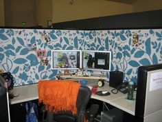 Cubicle decor - wallpaper cut and pinned onto the boring gray fabric walls.