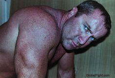 hunky wrestler dad on wrestling mats