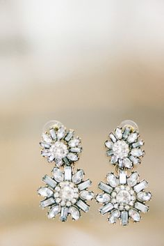 starburst earrings, photo by Elizabeth Fogarty http://ruffledblog.com/patapsco-female-institute-wedding #jewelry #weddingjewelry