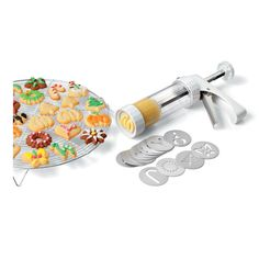 Cookie Press with Storage Box $89.00  Hearts, pinwheels, ovals and squares - make dozens of yummy cookies in a flash! Sold at all Metro Woodlands Departmental Stores. Visit www.metro.com.sg for more information or LIKE our Facebook page at www.facebook.com/metrosingapore