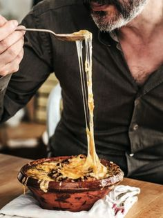 David Lebovitz's French Onion Soup--how can you look at that beautiful string of cheese and not want some of this?