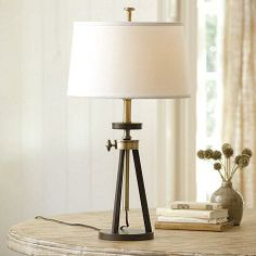 This table lamp is inspired by the design of a 19th-century surveyor's tripod.