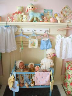 vintage baby dolls and nursery things, nice display