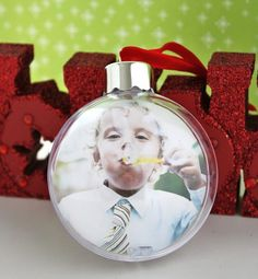 DIY Christmas Ornament Craft - picture in a glass ball - I've done this type of ornament but the bubble blowing pic is genius - looks like he's blowing himself into the bubble.