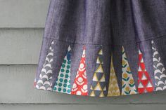 Backgammon Skirt by The Long Thread - directions & template available to download for free! We love how the design makes these fun stamped prints peekaboo out for a fanning effect. #sewing #tutorial #diy