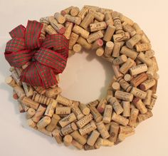DIY Wine Cork Wreath-----12 inch Straw wreath base, Hot Glue Gun,   Glue Sticks, (I used a lot. Most of a bag of 200 mini sticks.)   Wine Corks (120 for the first row, Another 100+ for the second row),   Twine or Floral wire,   a vacuum (to clean up, the straw wreath makes a mess)  ****I also used red berries and places them all over the wreath - so EZ!