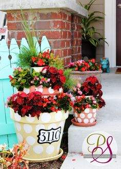 picket fences, polka dots, painted pots, decorating ideas, potted flowers, flower pots, porch decorating, house numbers, front porches