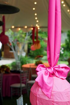 Love the look of these paper lanterns hanging from a satin ribbon