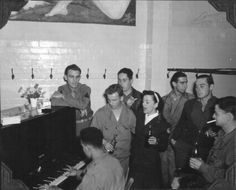 Singing with a Red Cross girl at the Aero Club at the 381st BG.