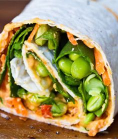 Hummus, avocado, edamame, carrots, & spinach wrap noheat lunch, sandwich, carrot, food, edamame, pepper, hummus, spiral, healthy lunches