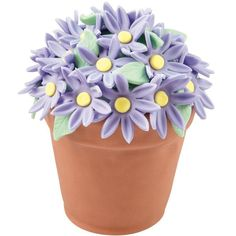 Pretty purple daisies present the colors of spring. Make these mini cakes using our Flower Pot Mini Cake Pan.
