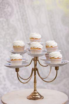 Candelabra-turned-cupcake stand.