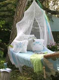 putting a mosquito net around a hammock seems like a good way to not only make the hammock cuter, but keep the place feeling restful (b/c you won't have to constantly swat bugs away).  but even without a hammock, maybe just putting a mosquito net around a picnic area is a good idea!  :D