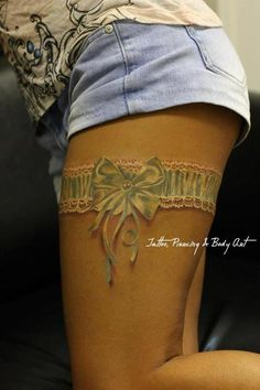 Garter Tattoo....want this but the garter I wear on my wedding day with my husband's name on it some were