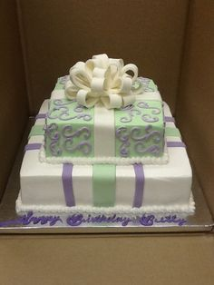 Calumet Bakery  Buttercream cake lavender, pale green and white present two tier