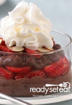 Strawberry Chocolate Pudding Parfaits... A delicious dessert that doesn't involve cooking or baking! Sweet strawberries covered in chocolate pudding, topped with fluffy whipped topping.