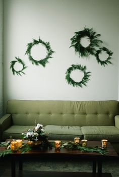Simplify. Wreath Wall Decor for the holidays | Photography: Brooke Schultz Photography | On SMP: http://www.stylemepretty.com/utah-weddings/salt-lake-city/2013/11/29/salt-lake-city-utah-holiday-engagement-inspiration-shoot-from-brooke-schultz-photography