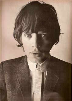 Mick Jagger by David Bailey.     Amazing vintage photograph of a young Jagger from The Rolling Stones.     #rock #music #lips #london #vintage #history #suit #scruffy #hair #sex #drugs #voice #sing #hits #icon #iconic #rocker #shirt #button #jacket #1960's #classic