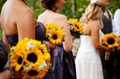 Sunflower bouquets from rusticweddingchic.com