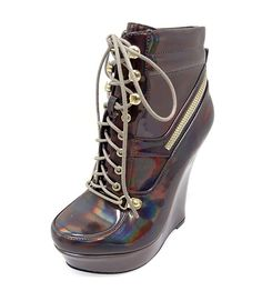 Sexy, lace-up booties designed with a gorgeous cocoa coloring with a metallic sheen, have a zipper ribbing around the sides and back, and have a wedge heel...