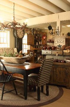 Beautiful Country Home...love the dough bowl on the table & the cupboards and clock.