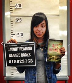 Mug shot photo booth...could use this for a library display someday, banned books week.