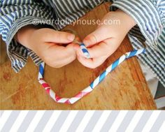 fine motor skill practice for toddlers—stringing paper straw necklaces