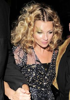 She is gorgeous! xo Vogue Kate Moss on her 34th birthday. Sporting a fresh-from-vacation tan and ever-so-contoured cheeks, she maintained rocker mystery with kohl-rimmed eyes while her soaring pile of disco curls was practically an insurance policy for fun. Gold star, Kate.