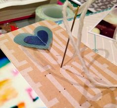 love stitching  using Amy Tangerine & a needle & thread to sew the love on my 4x6 title card :)