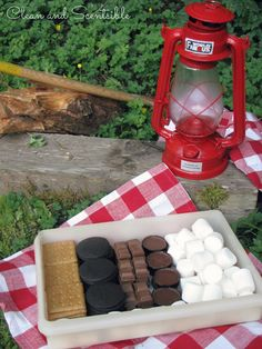 Make a s'mores box to store all of your supplies! Duh.... So annoying to juggle the pack of crackers, the sticky bag of marshmallows, the candy bar... It won't change the world, but it will simplify my camping!