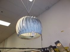 SOLD - This is a repurposed metal turbine hanging light will make a unique addition to any room *** In Booth M111 at Main Street Antique Row 7336 E Main St (east of Power RD on MAIN STREET) Mesa Az 85207 **** Open 7 days a week 10:00AM-5:30PM **** Call for more information 480 924 1133 **** We Accept cash, debit, VISA, MasterCard or Discover.