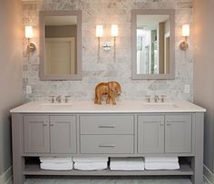 Refined LLC: Exquisite bathroom with freestanding gray double sink vanity topped with white counter. ...
