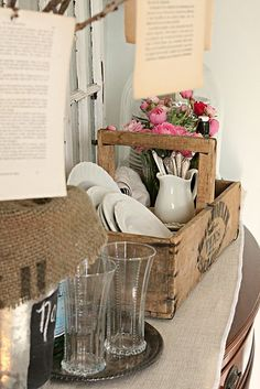 crate with dishes and flowers