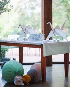 Guests' names and table assignments were printed on agate slices and set out on a table with two oversize paper cranes.