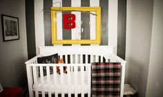 Black & white stripes pop with #yellow & #red accents.  #nursery #black #stripewall