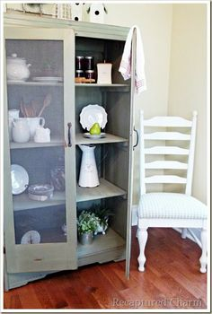 Love this! Old armoire turned into a kitchen cabinet.