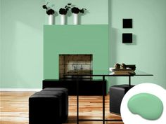 Inky furnishings and accents give these calming shades a dose of adrenaline. Shown here: Sherwin-Williams' Vegan SW 6738 (fireplace), Reclining Green SW 6744 (walls). | Photo: Courtesy of Sherwin-Williams
