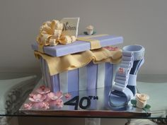 Custom Birthday Cake representing a shoe box and stiletto healed shoe for a customer's 40th Birthday.