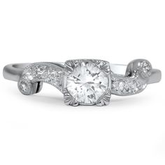 Elegant diamond ring with ribbon swirl sides.