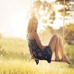 Swing senior picture ideas for girls. Senior picture ideas for girls on swings.  #seniorpictureideas  #swingseniorpictures #seniorpictureideasforgirls