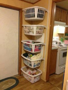 laundry station -- inside closet -- hides dirty clothes -- two wall standards and some brackets to hold the laundry baskets. Love this idea!