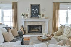 City Farmhouse: (check out the entire family room reveal - great decor on a budget!)j I would do something different with the deer head painting....like a vintage mirror, or something along those lines!