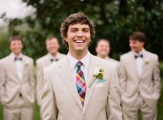 Groom with tie, groomsmen with bowties