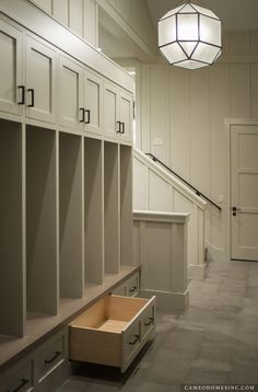 Mudroom with Lockers and pull-out drawers. Home built by Cameo Homes Inc. in Utah.