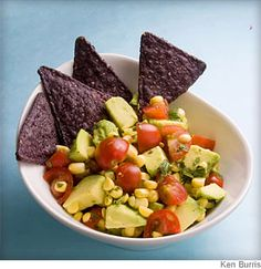 This colorful salsa comes together in a snap with avocado, frozen corn and ripe tomato.