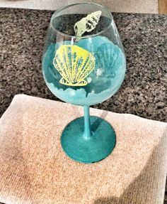 DIY wineglass painting, choose any glass acrylic gloss paint and design. I chose an ocean theme.