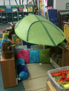 "awesome reading corner. pretty sure i saw the ""leaf tent"" at Ikea"