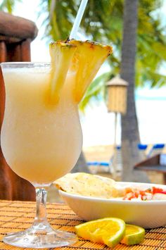 Pina Colada (virgin):       1 cup pineapple juice      1 cup crushed pineapple      1/2 cup coconut milk (canned or fresh)      juice from one lime      ice to top of blender    Preparation:  Blend ingredients until ice is slushy. Pour into frosted glasses and enjoy immediately.