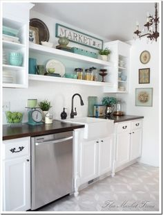 love everything about this! White cabinets, dark countertop, turquoise accents.
