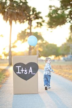 gender reveal! Love this Idea! Get a picture of Emma holding a pink/blue balloon!